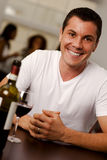 Handsome young man in a restaurant. Portrait of a handsome young man looking to camera in a restaurant Stock Photo