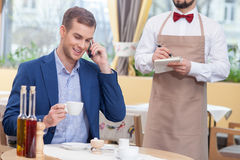 Handsome young man is resting in cafe Stock Photography