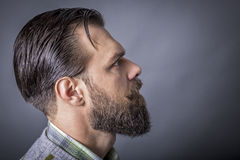 Handsome young man with retro look, beard and mustache Royalty Free Stock Photo