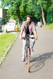 Handsome young man riding his bicycle Royalty Free Stock Photo
