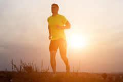 Handsome young man running in the park. Royalty Free Stock Photography