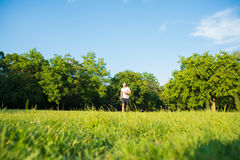 A handsome young man running in a park Royalty Free Stock Images