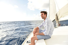 Handsome young man on sailing boat Royalty Free Stock Photos