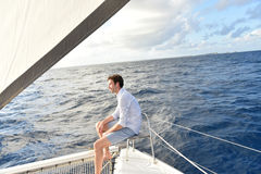 Handsome young man sailing Royalty Free Stock Photography