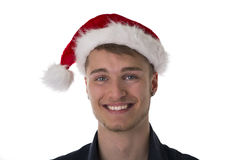 Handsome young man in Santa Claus red hat for Christmas Royalty Free Stock Photography