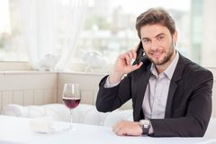 Handsome young man schedules an appointment with Royalty Free Stock Photo