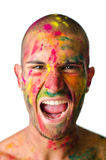 Handsome young man screaming with face's skin all painted with colors. Headshot of young man screaming with face's skin all painted with bright colors, isolated Stock Images