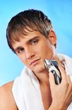 Handsome young man shaving Royalty Free Stock Images