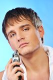 Handsome young man shaving Stock Image