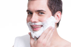 Handsome young man with a shaving foam stock photos
