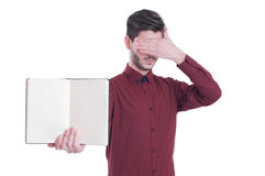 Handsome young man in shirt holding notebook copy space Stock Photography