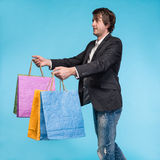 Handsome young man with shopping bags Royalty Free Stock Images