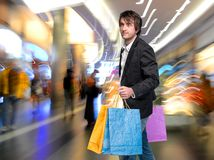 Handsome young man with shopping bags Stock Image