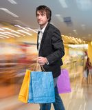 Handsome young man with shopping bags Stock Photos