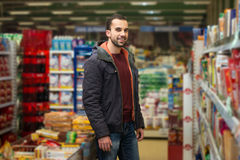 Handsome Young Man Shopping In A Grocery Supermarket Stock Image