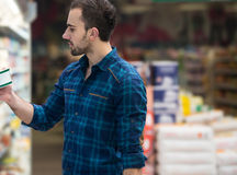 Handsome Young Man Shopping In A Grocery Supermarket Royalty Free Stock Images