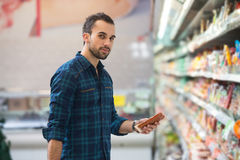 Handsome Young Man Shopping In A Grocery Supermarket Stock Images