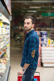 Handsome Young Man Shopping In A Grocery Supermarket Royalty Free Stock Photo