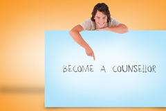 Handsome young man showing card with become a counsellor Royalty Free Stock Photography