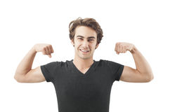 Handsome young man showing his muscles Royalty Free Stock Images
