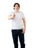 Handsome young man showing thumbs up Stock Photography