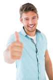 Handsome young man showing thumbs up to camera Royalty Free Stock Photo