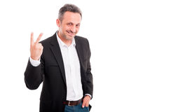 Handsome young man showing victory fingers sign. Or counting number two isolated on white Royalty Free Stock Photos