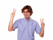 Handsome young man showing you victory sign Royalty Free Stock Images