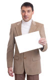 Handsome young man shows paper sheet Royalty Free Stock Photography