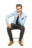 Handsome young man sitting Stock Photography