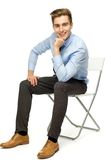 Handsome young man sitting Royalty Free Stock Photography