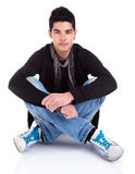Handsome Young Man Sitting on the Floor Royalty Free Stock Images