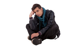 Handsome young man, sitting on the floor Stock Images
