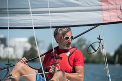 Handsome young man sitting on hobie cat Royalty Free Stock Photo