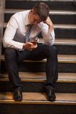 Handsome young man sitting on stairs. Royalty Free Stock Image
