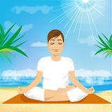 Handsome young man sitting in yoga pose Stock Images