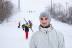 Handsome young man on a ski slope royalty free stock images