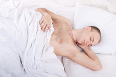 Handsome young man is sleeping Royalty Free Stock Photography