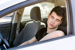 Handsome Young Man sleeping in a Car Stock Photos
