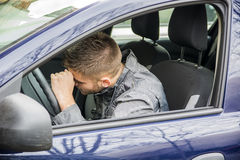 Handsome Young Man sleeping in a Car Royalty Free Stock Image