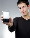 Handsome young man with a smartphone Stock Photos