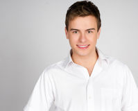 Handsome young man smiles Stock Photos
