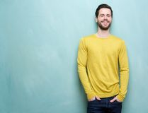 Handsome young man smiling against blue background Royalty Free Stock Photography