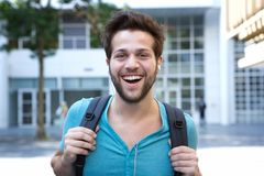 Handsome young man smiling with bag Royalty Free Stock Photos