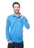 Handsome young man smiling in blue shirt Stock Images