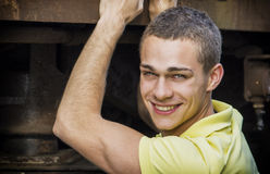 Handsome young man smiling at camera Royalty Free Stock Photos