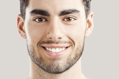 Handsome young man smiling Stock Photos