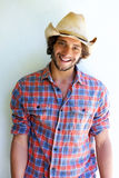 Handsome young man smiling with cowboy hat Royalty Free Stock Images