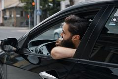 Young man smiling while driving a car Royalty Free Stock Image