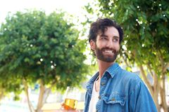 Handsome young man smiling with glass of beer Royalty Free Stock Photo